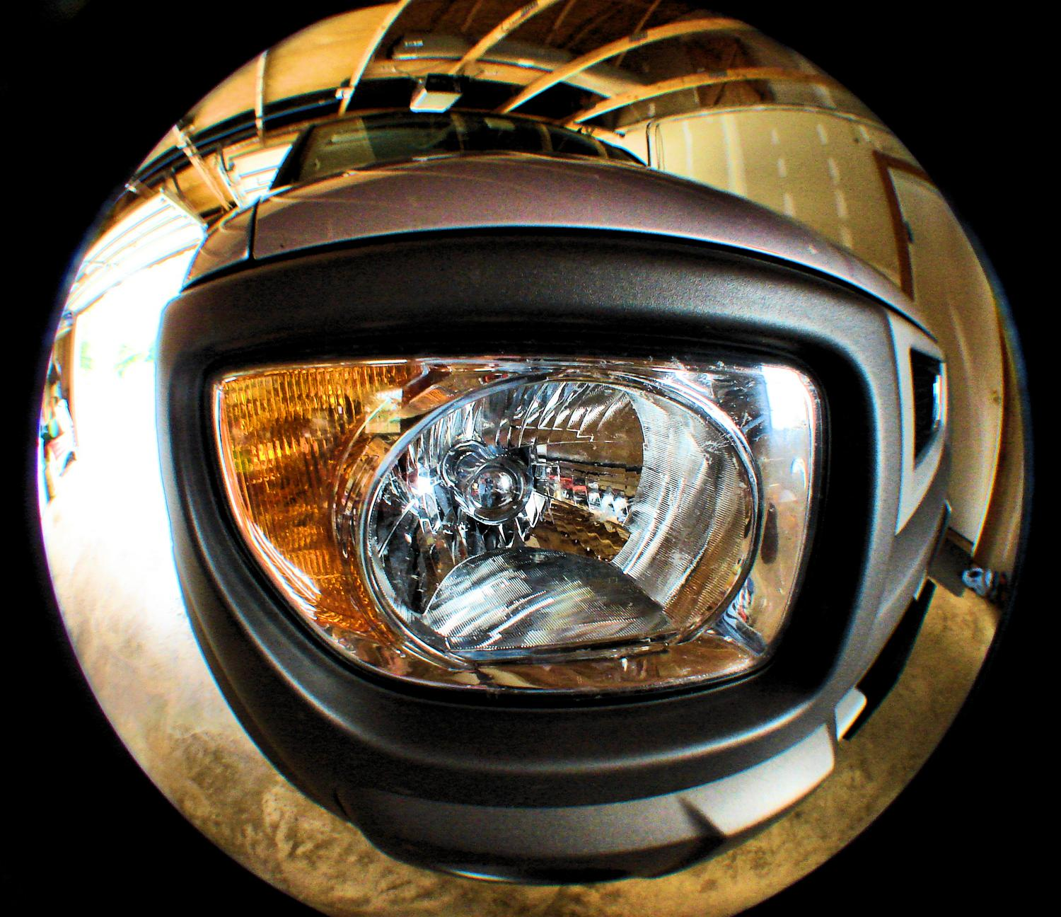 fisheye view of the front headlight of a Honda element - I bought my new car on the same day we bought the house - Tony Karp, design, art, photography, techno-impressionist, techno-impressionism, aerial photography , drone , drones , dji , mavic pro , video , 3D printing - Books -