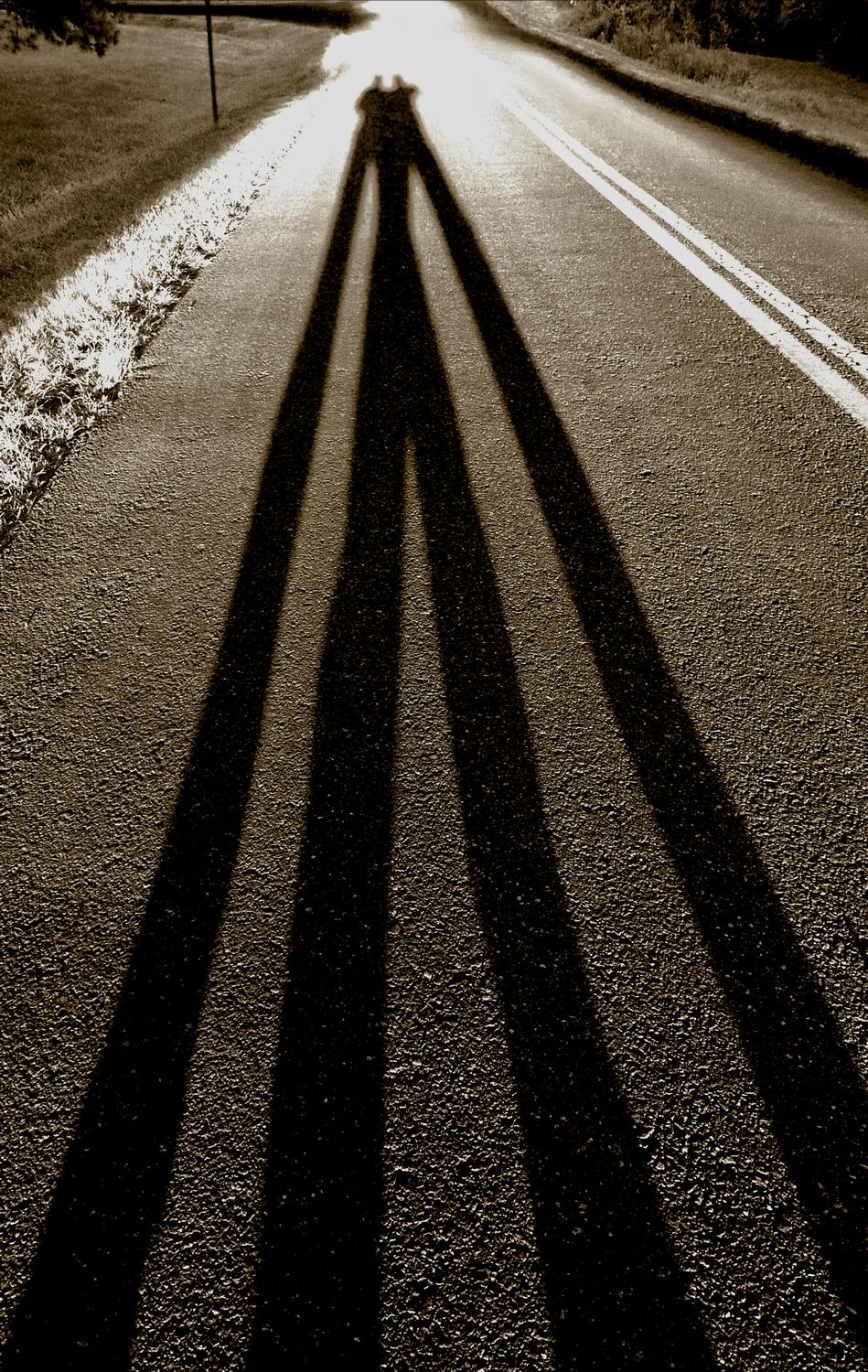long shadows on the road - The artist and his muse intertwined on the road - Panasonic DMC-FZ28 - Tony Karp, design, art, photography, techno-impressionist, techno-impressionism, aerial photography , drone , drones , dji , mavic pro , video , 3D printing - Books -